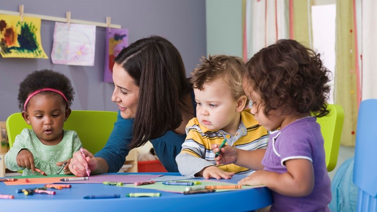 Teacher and toddlers in daycare CDC FCC web.jpg